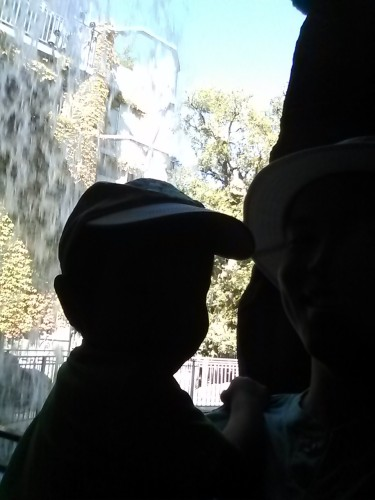 Then you heard a train. On the way to the station, we got all wet playing behind a waterfall