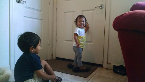 """Mama: """"j just put on my purple sanuks and tried to open the front door... She can reach the doorknob just fine..."""""""