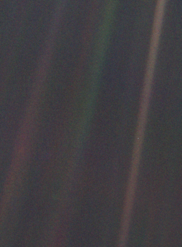 Seen from about 6 billion kilometers, Earth appears as a tiny dot (the blueish-white speck approximately halfway down the brown band to the right) within the darkness of deep space