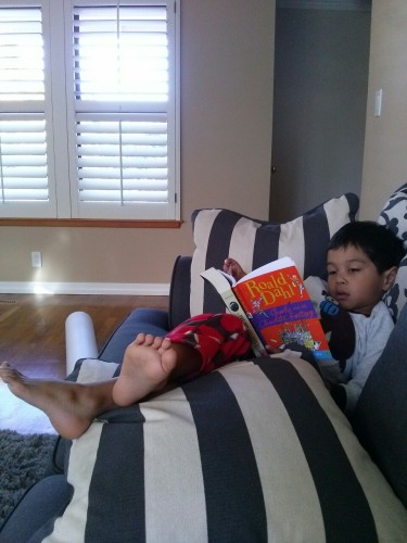 Here we are reading together on the couch. You're reading James and the Giant Peach.