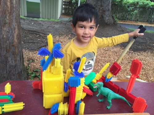 """I wanted to make sure I shared the photograph of Joshua's dinosaur obstacle course that he built with bristle blocks in the grove area yesterday. He asked me to take a photo of it and send it over. Here is his message to you: """"I love you. I hope to see you soon. This is my obstacle course for the dinosaurs."""""""